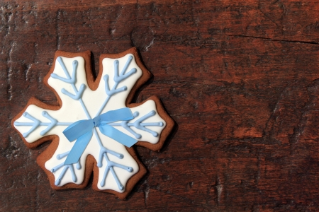 Christmas gingerbread snowflake cookie on a vintage wooden background   photo