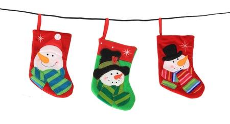 Christmas stockings hanging, studio isolated on white Stock Photo - 16738780