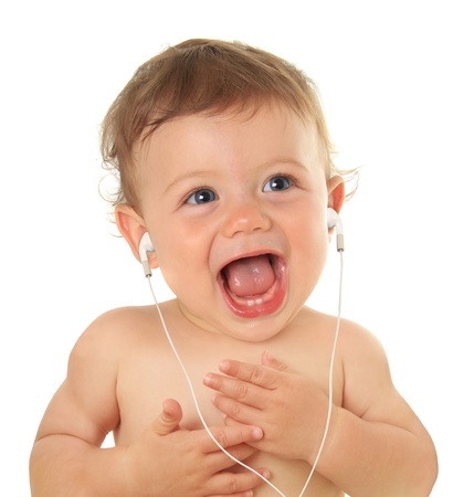 child singing: Adorable ten month old baby listening to music on earbuds