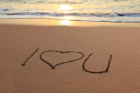valentine s day beach: I love you written in the sand on the beach at sunset   Stock Photo