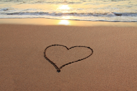 valentine s day beach: Heart in the sand on the beach at sunset