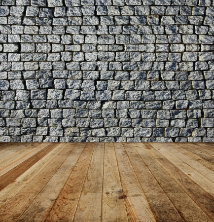 Old grey square brick wall and wooden floor Stock Photo - 17960028