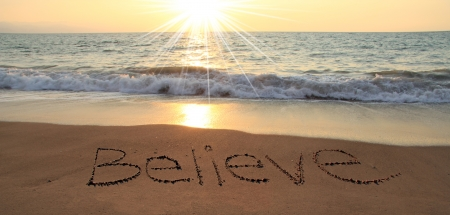 Believe written in the sand at the beach Stock Photo - 17959979