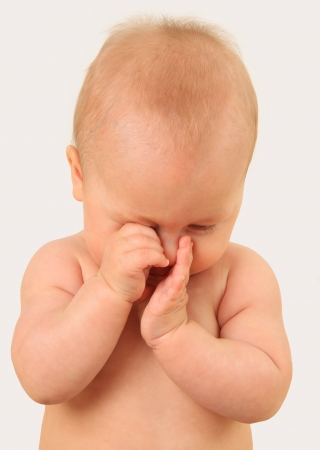 Baby rubbing eyes Stock Photo - 18126505
