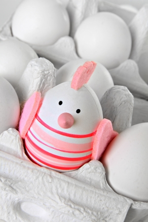 Easter egg chick ornament in an egg carton   Stock Photo - 18138149