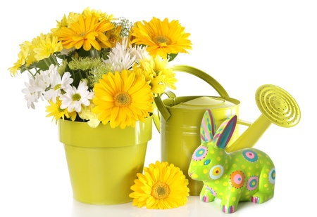 Yellow Easter bunny and spring flower arrangement   Stock Photo - 18138146