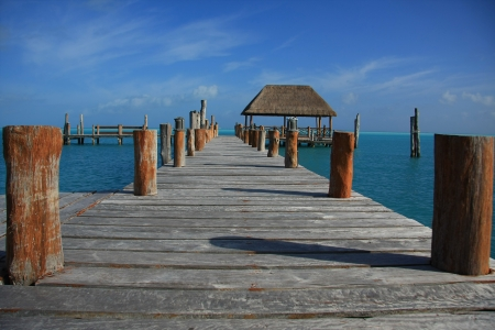 Beautiful wooden dock in Caribbean tropical waters   Stock Photo - 18138147