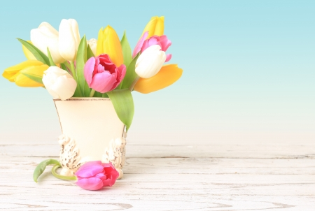 room for text: Tulip flowers in a vintage little vase   Stock Photo