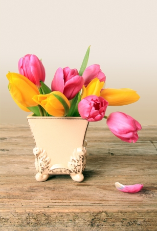 Tulip flowers in a vintage little vase  Also available in horizontal Stock Photo - 18653186