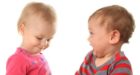 eager: One year old babies  An eager boy and a shy girl   Stock Photo
