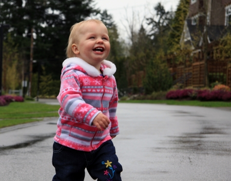 One year old happy girl running outside Stock Photo - 19126474