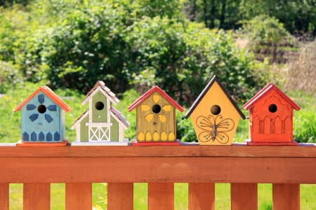 Collection of colorful wooden birdhouses