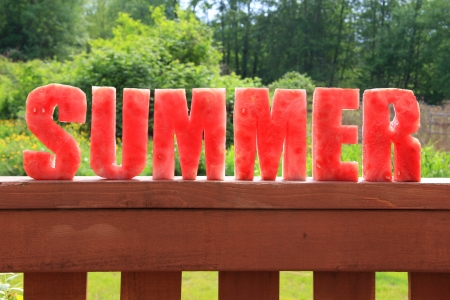 Summer spelled in letters cut out of watermelon   photo