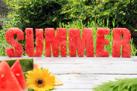 Summer spelled in letters cut out of watermelon. photo
