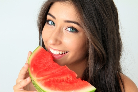 Beautiful smiling young woman with a slice of watermelon  photo