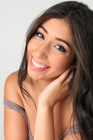 Beautiful smiling young woman with long dark hair  photo