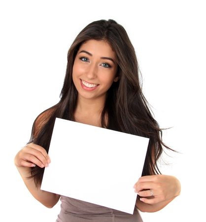 Beautiful smiling young woman holding a white sign  Add your own text  photo