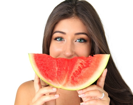 Beautiful smiling young woman with a slice of watermelon