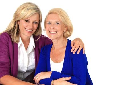 two women hugging: Two women hugging, studio isolated on white.