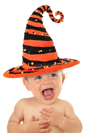 Adorable ten month old baby wearing a Halloween witch hat