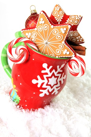 Christmas mug filled with gingerbread cookies and candy   photo