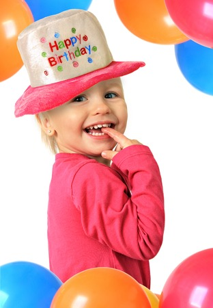Happy smiling two year old Birthday girl.  photo