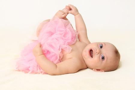 Baby girl wearing a pink tutu photo
