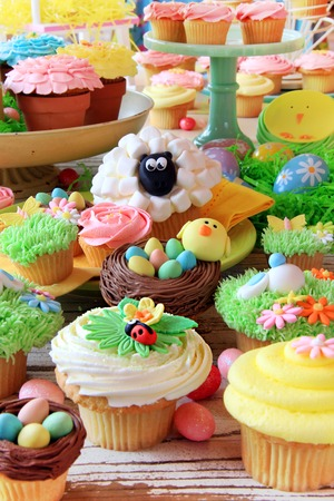 Easter cupcakes and Easter eggs display  Also available in horizontal   photo
