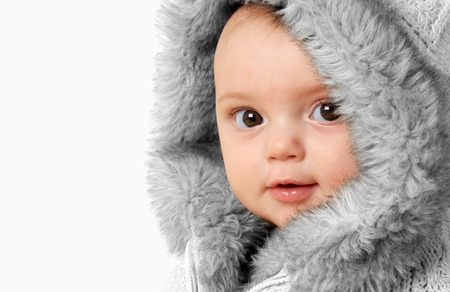 Baby girl wearing a winter fur coat   photo