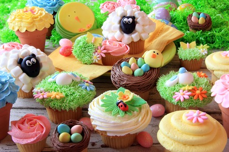 easter morning: Easter cupcakes and Easter eggs display  Also available in vertical  Stock Photo
