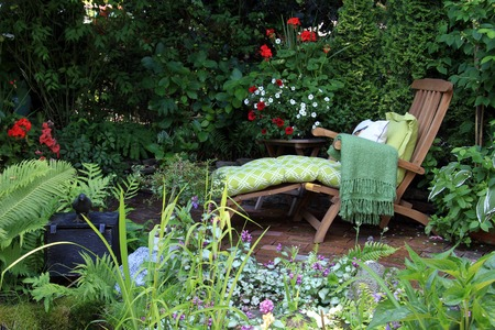 water feature: Comfortable lounge chair in a small garden. Also available in vertical.