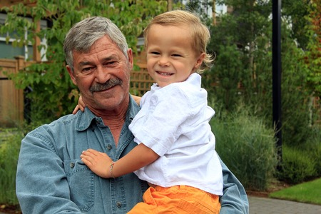 causasian: Grandfather and his four year old grandson.
