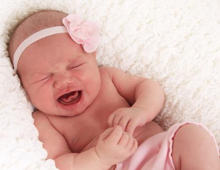 Newborn baby girl crying loudly. Archivio Fotografico