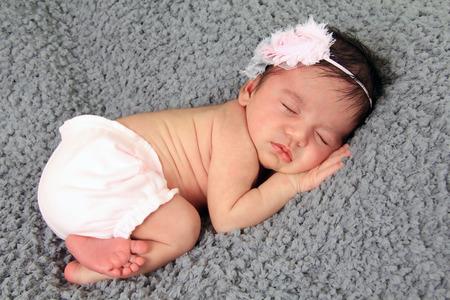 bi racial: Newborn baby girl of Caucasian and Asian heritage.