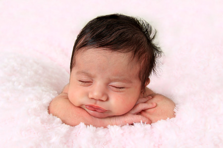 cute: Newborn baby girl of Caucasian and Asian heritage.