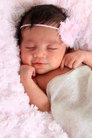 Beautiful newborn baby girl smiling. photo