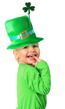 Happy smiling two year old girl wearing a St Patrick