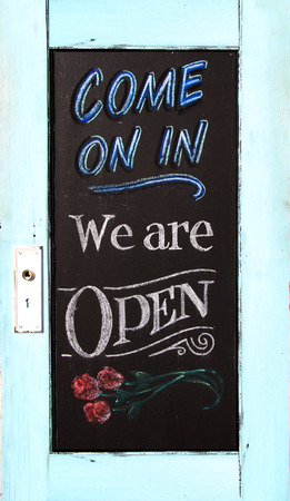 come in: Chalkboard welcome sign in a weathered wood frame. Stock Photo