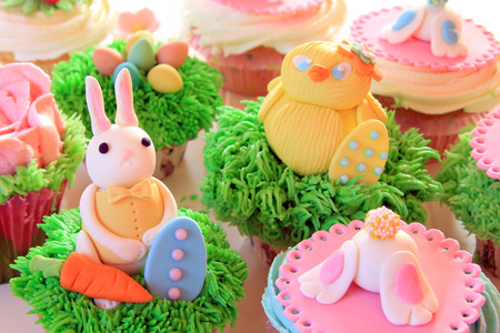 easter morning: Easter bunny cupcakes with Easter eggs and a chick made of fondant.