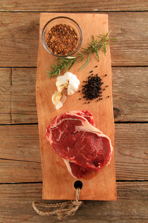 prime rib: Raw prime rib beef steaks with spices, garlic and rosemary.