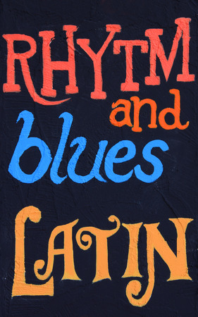 rhythm: Rhythm and blues, latin, painted on a stucco wall. Part of a series.