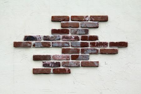 stucco: Stucco and brick wall.
