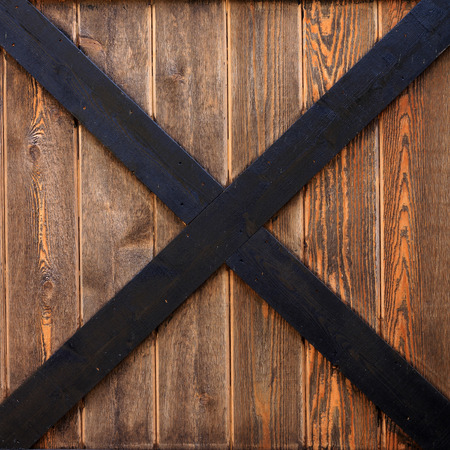 black boards: Close up of a cedar wood barn door panel.