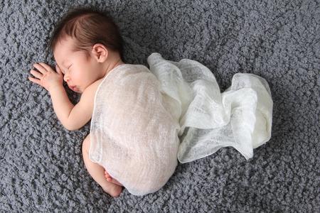 newborn baby: Newborn baby girl asleep on a blanket.