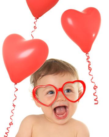 human heart: Diez meses de edad del bebé que llevaba gafas de corazón shape valentine. Foto de archivo