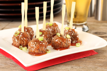 Cocktail beef meatballs in sweet and sour sauce. Also available in vertical. Stockfoto