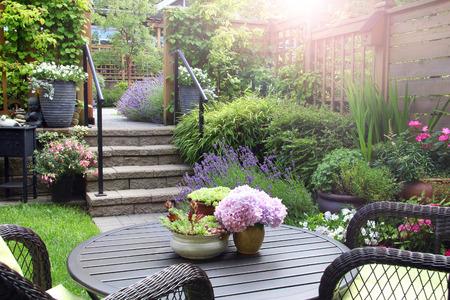 flower garden: Small townhouse perennial summer garden Stock Photo