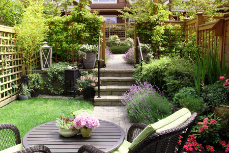 Small townhouse perennial summer garden Stock Photo