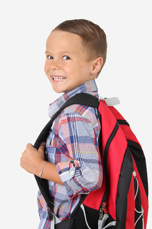 Young boy wearing a backpack. Back to school concept. Stock Photo
