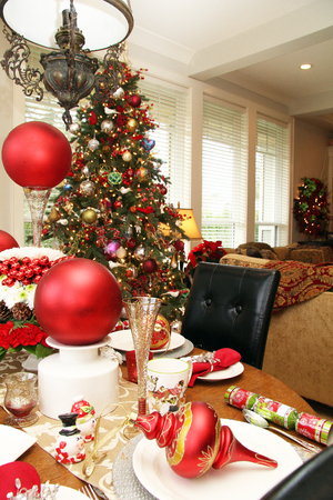 christmas cracker: Christmas table setting and tree in a cozy living room.